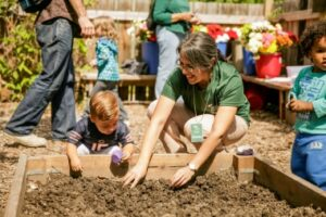 adult and child playing in soil