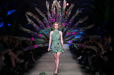 fleurotica 2019 runway shot of melinda whitmore peacock dress