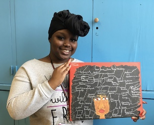 Al Raby Student holding her artwork
