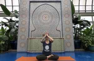 Yoga Instructor posing in front of Moroccan Fountain at Garfield Park Conservatory